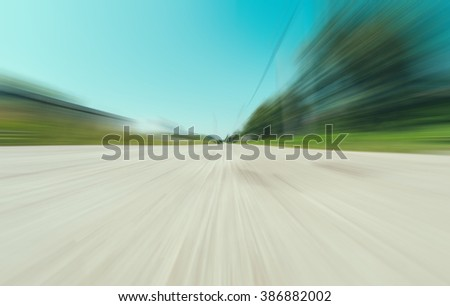 Blurred speed motion send road in the village - stock photo