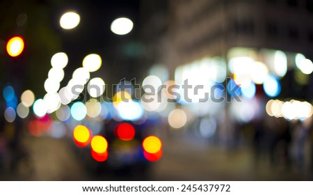 blurred street lights in the night, abstract background - stock photo