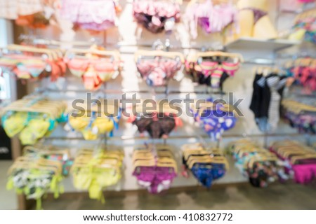 Blurred Swim suits department in clothing store, lifestyle shopping concept - stock photo