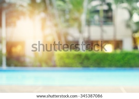 blurred swimming pool on nature and hotel background - stock photo