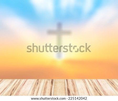 Blurred the cross on a sunset and wooden paving - stock photo