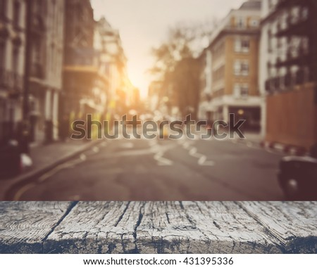 Blurred Traffic and Buildings in Downtown of City with Retro Style Filter - stock photo