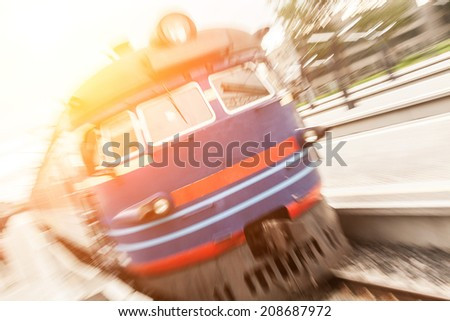 Blurred Train in Tallinn Station - stock photo