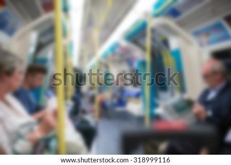 Blurred underground wagon with people. London, UK. Defocused image. - stock photo