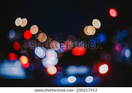 Blurred unfocused city view at night background - stock photo