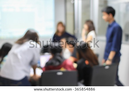 blurred university students training/reading/disciplining lesson for examination:blur group of asian pupil doing and practice homework in silence classroom at library:blurry of education concept. - stock photo
