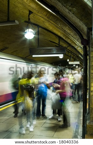 Blurred unrecognizable people ready to take subway. - stock photo