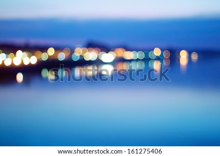 Blurred view of city on a shore - stock photo