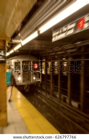 Blurred view of Subway train, NYC.
