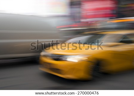 Blurred view of Yellow taxi moving in Times Square, Manhattan, New York City, New York State, USA - stock photo
