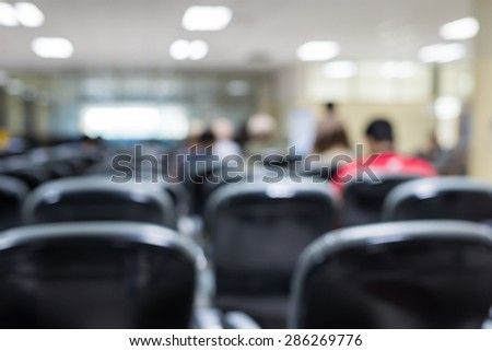 Blurred waiting chairs zone in airport