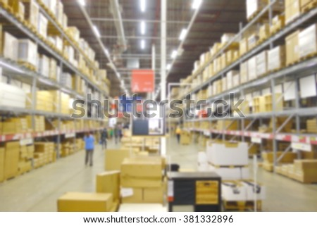 Blurred warehouse facility and cardboard boxes  - stock photo