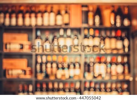 blurred wine bottles on the store shelves - stock photo