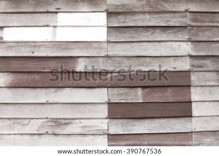 Blurred wooden background with toned pale color and out of focus for background