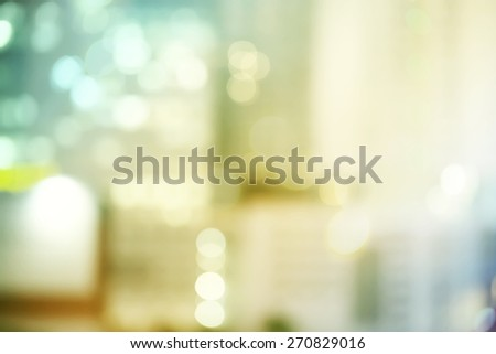 Blurred yellow and green urban building background scene  - stock photo