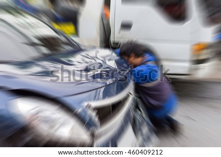 Blurred zoom of  Car crash from car accident on the road in a city between saloon versus pickup wait insurance. - stock photo