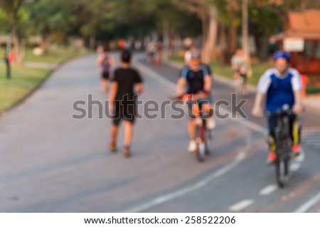 Blurring of the park in the morning,some ran and some cyclists. - stock photo