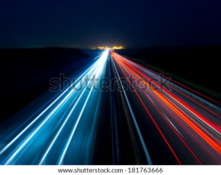 Blurry abstract photo of the lights of cars on the highway - stock photo