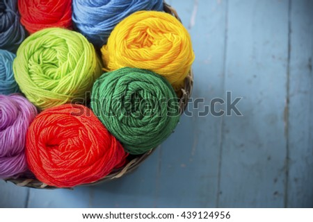 Blurry background colorful knitting in wooden basket  - stock photo