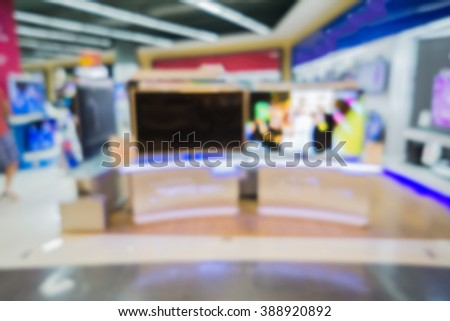 blurry background of a shop selling household appliances and TVs  was blurred for use as a background,vintage color - stock photo