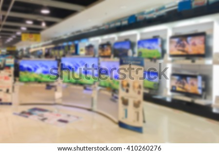 blurry background of a shop selling household appliances and TVs was blurred for use as a background,can be used for text or display your products - stock photo