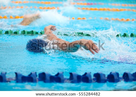 Blurry background of splash drop water on swimming race with swimming competition.