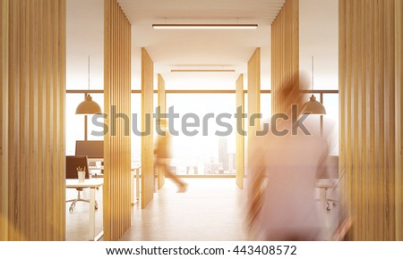 Blurry businesspeople walking in open office interior with wooden partitions, concrete floor, ceiling with lamps and New York city view.Toned image, 3D Rendering - stock photo