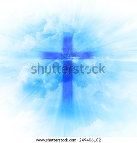 blurry Christian religious cross on blue sky background - stock photo