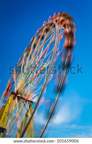 Blurry ferris wheel in motion - stock photo