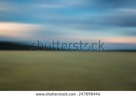 blurry field landscape useful as background - stock photo