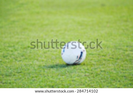 blurry football green grass ball stadium football field game sport background - stock photo