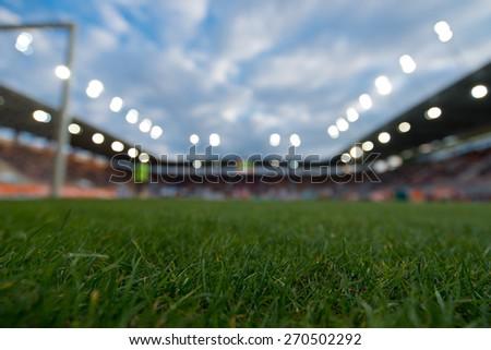 Blurry football stadium. - stock photo