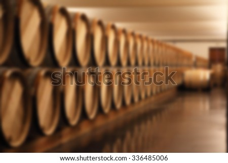 blurry image of wine barrel in cellar  - stock photo
