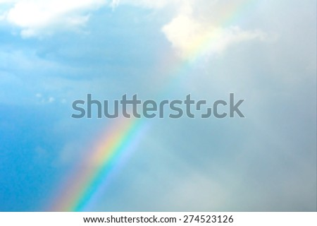 Blurry image - rainbow in the sky - stock photo