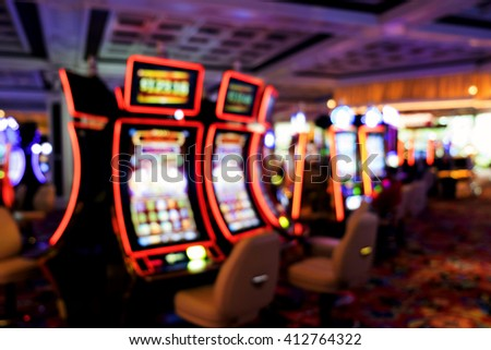Blurry image with Bokeh from slot machine in casino - stock photo