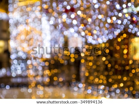 Blurry lights background. Christmas lights decoration in a department store. - stock photo