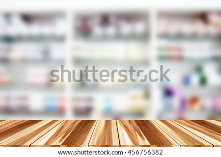 blurry medicine cabinet and store medicine and pharmacy drugstore for background with Perspective wood - stock photo