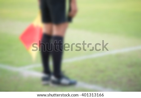 blurry,motion blur,Referee in action during competition football (soccer) - stock photo