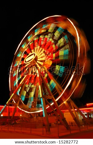 Blurry motion of Ferris Wheel - stock photo