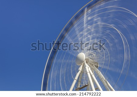 Blurry motion of the ferris wheel - stock photo