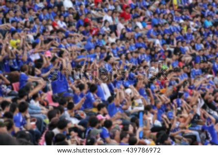 blurry of Soccer fans in a match and Spectators at football stadium - stock photo