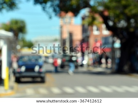 Blurry, out of focus abstract background of colorful outdoor street scene in Old Town, Key West, Florida.
