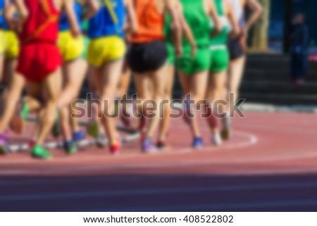 blurry runner are running on running track background - stock photo