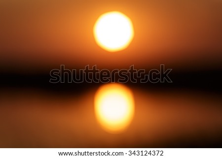 Blurry shot of landscape photo of sunset at lake. - stock photo
