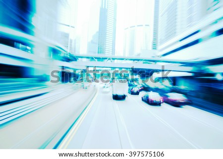 Blurry silver blue color tunnel high speed car driving. Motion blur visualizes the speed and dynamics.