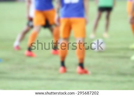 blurry soccer and football player training and playing football for background - stock photo