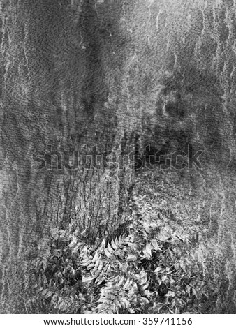 Blurry textured black and white photo of a large live oak tree with Spanish moss hanging from a branch and green plants below - stock photo