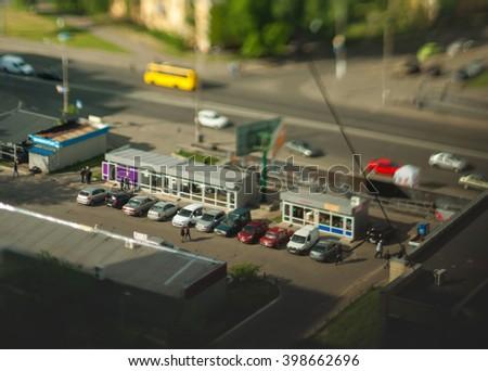 Blurry tilt-shift cityscape background - stock photo