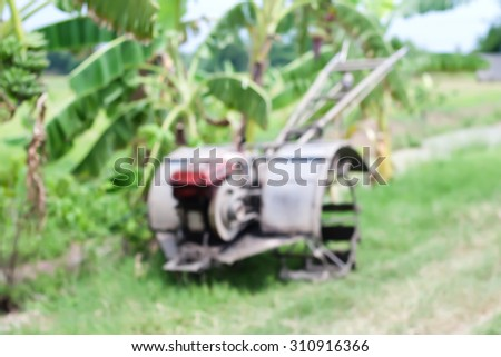 blurry tractor walk in thailand - stock photo