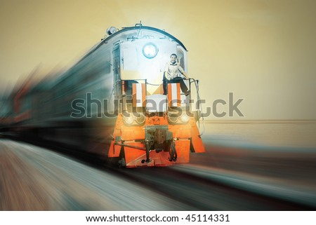 Blurry train with crazy driver on front - stock photo